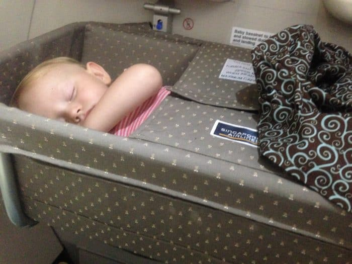 Singapore Airlines flying with a toddler, using a baby bassinet