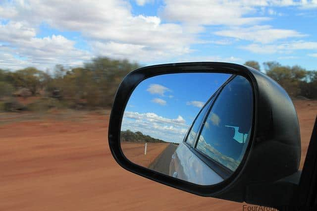 car mirror on road trip