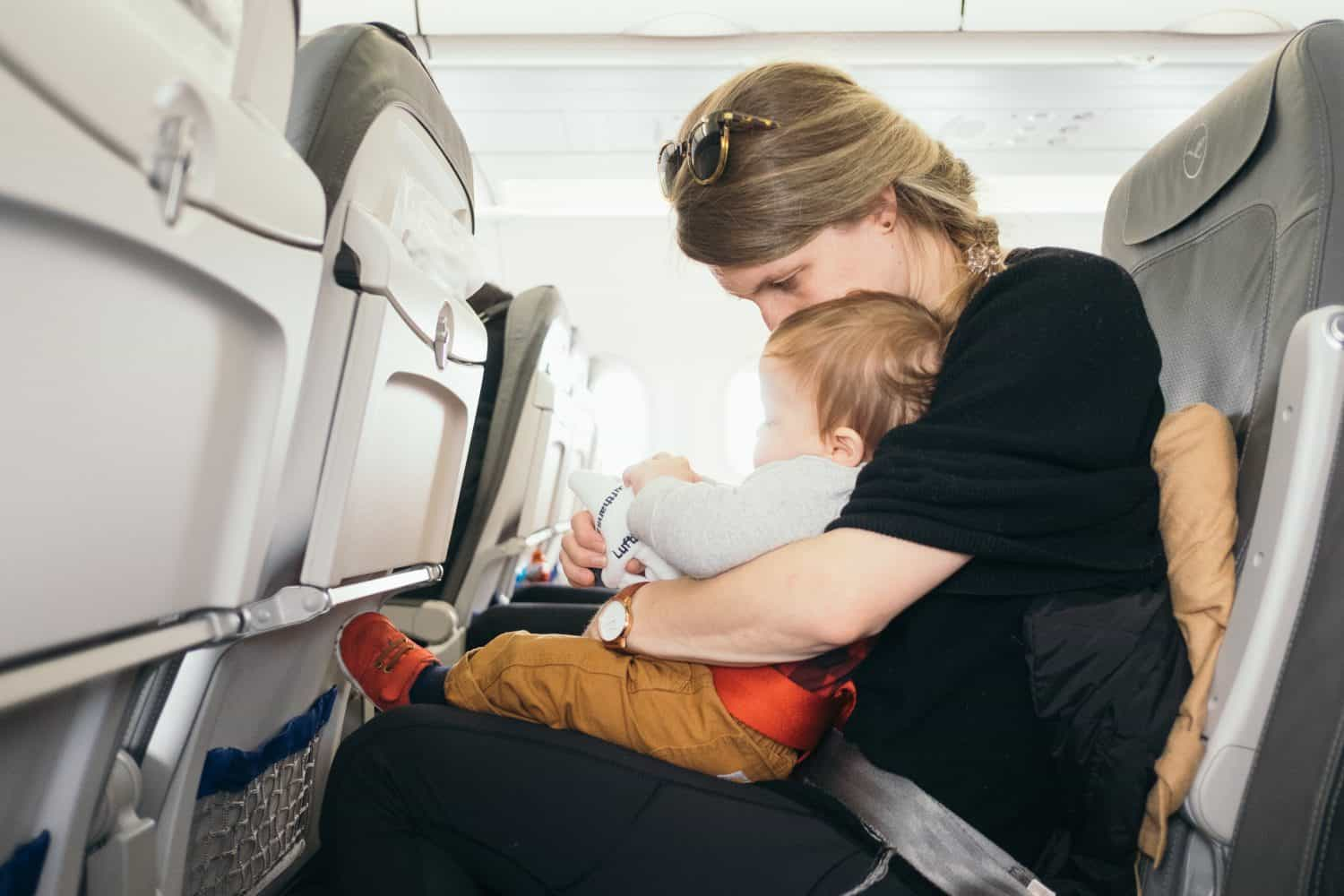 woman with baby on plane