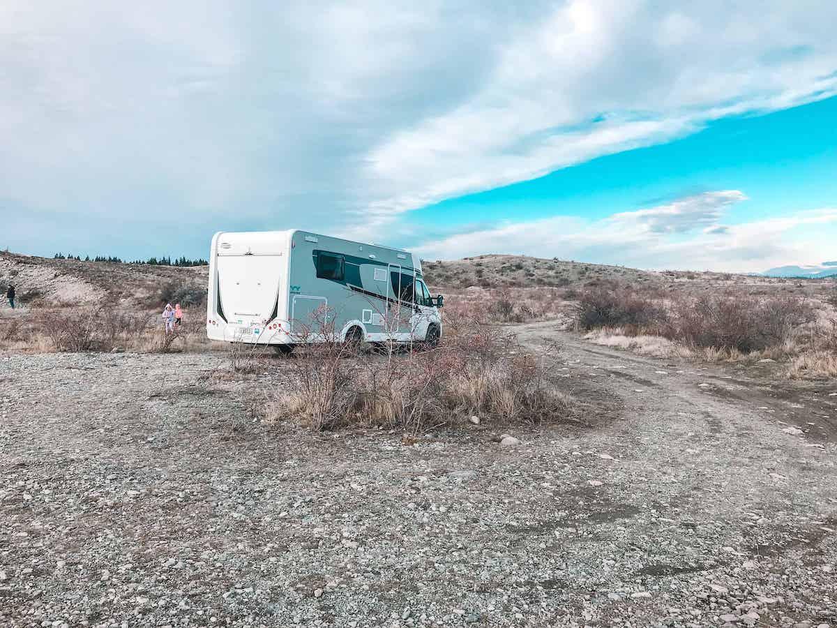 camping alongside lake tekapo