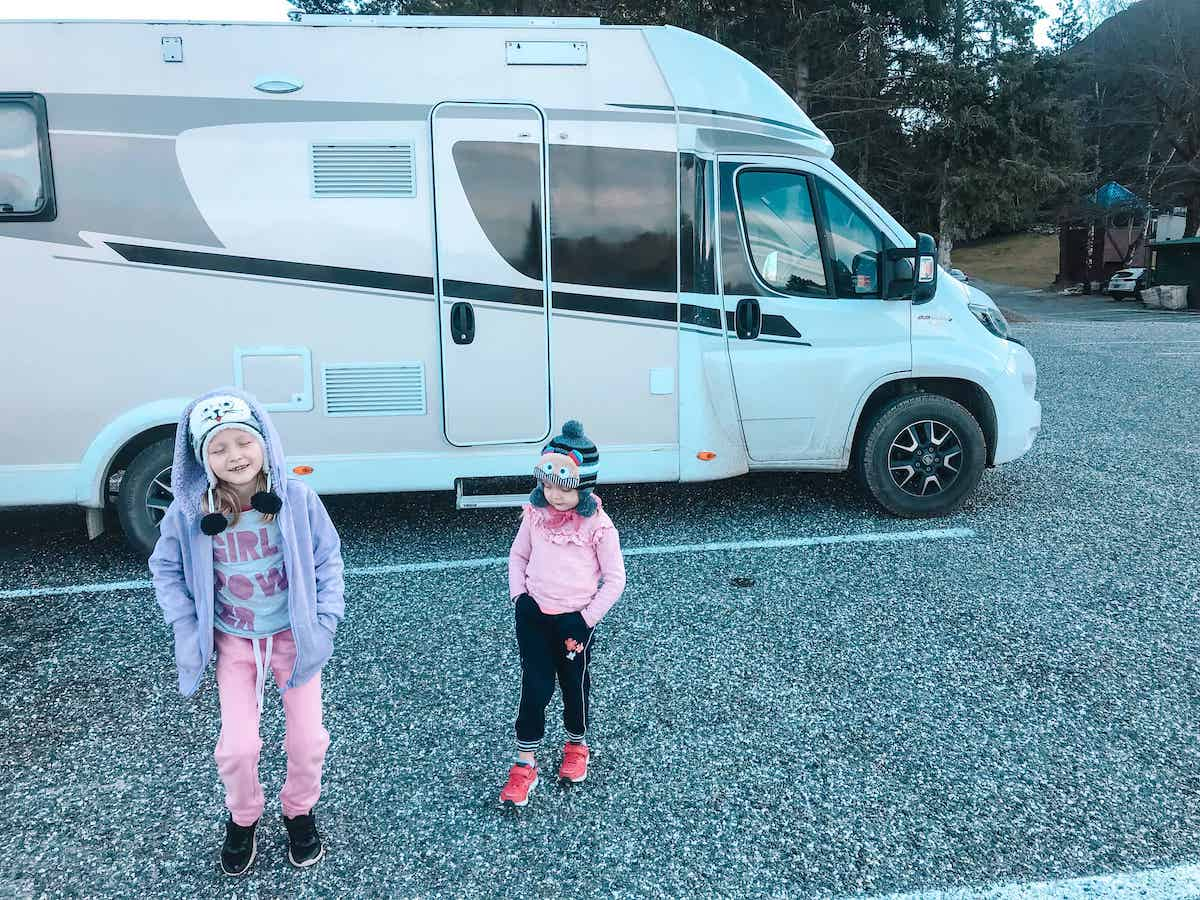 kids in front of campervan