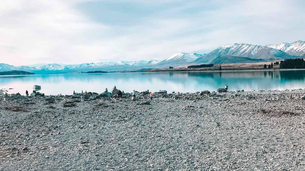 lake tekapo with snow capped mountains