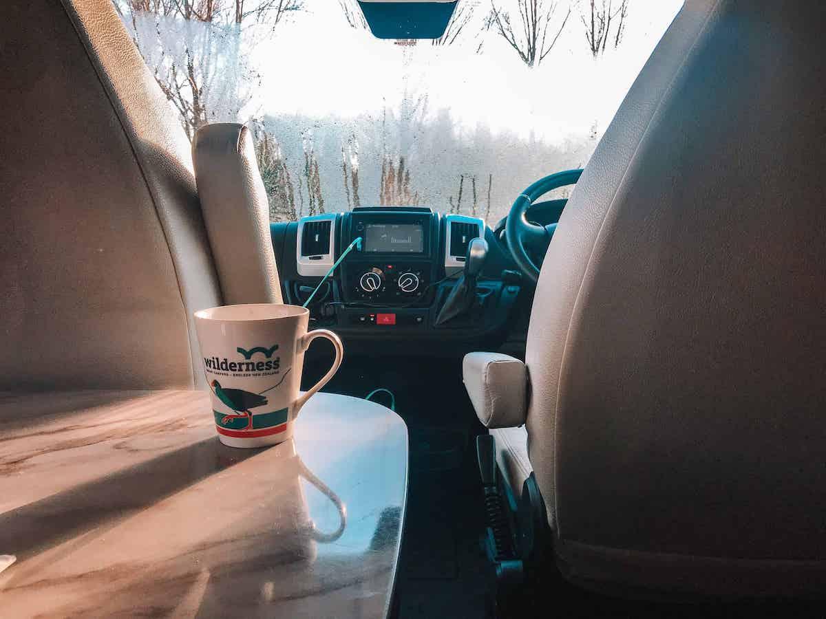 wilderness mug on campervan table
