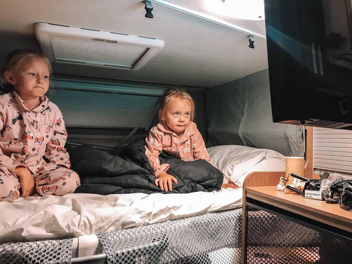 kids in campervan at night
