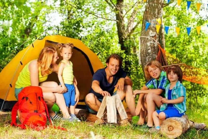 Family setting up camping with kids