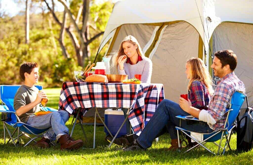 Family having lunch while camping