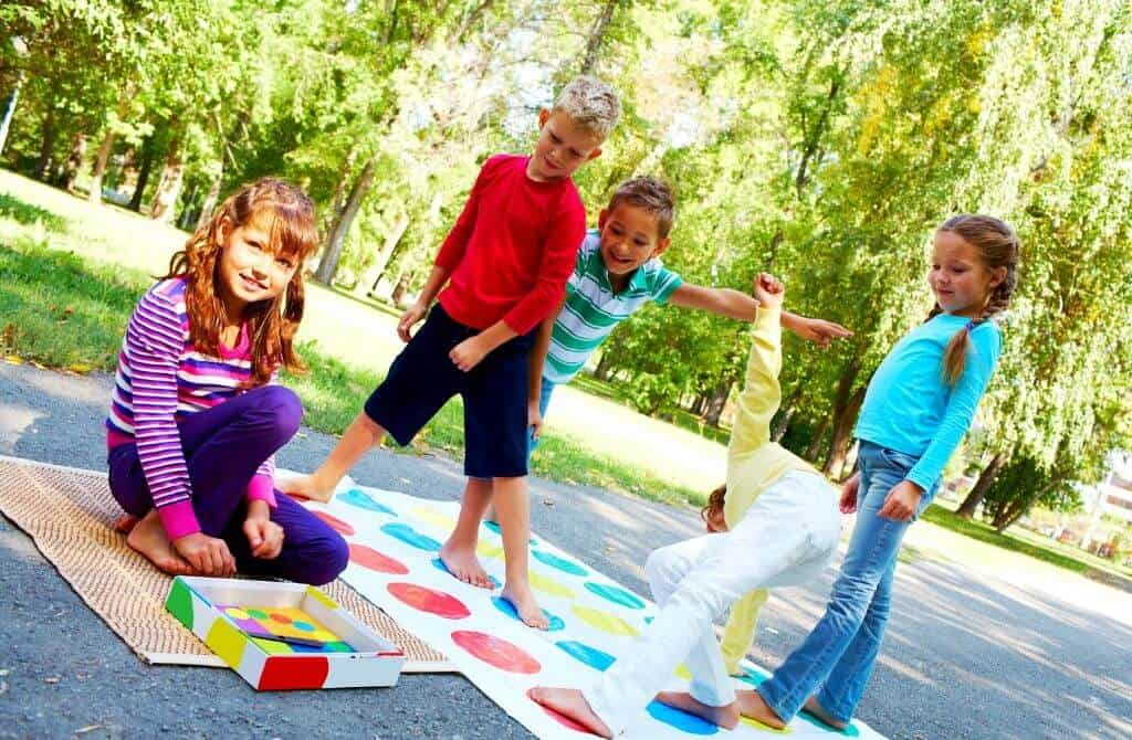 Kids playing outdoor games while camping with friends