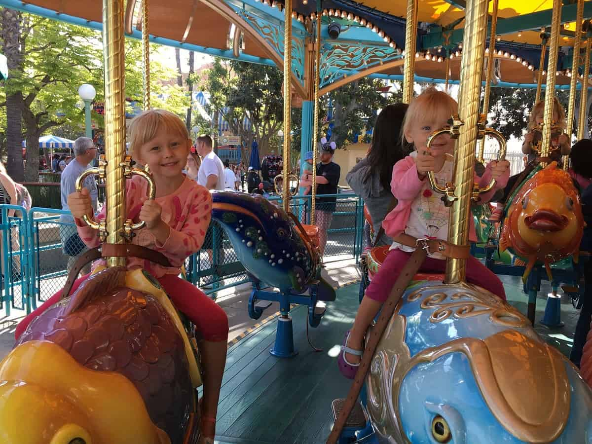 Disneyland with toddlers riding carousel
