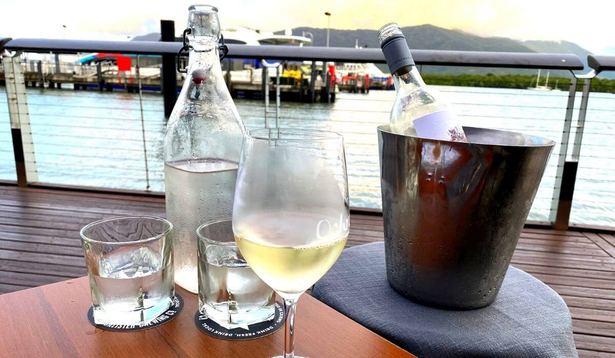 wine and glasses on the table at Cairns Marina