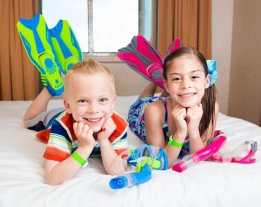 kids in cabin on cruise with flippers