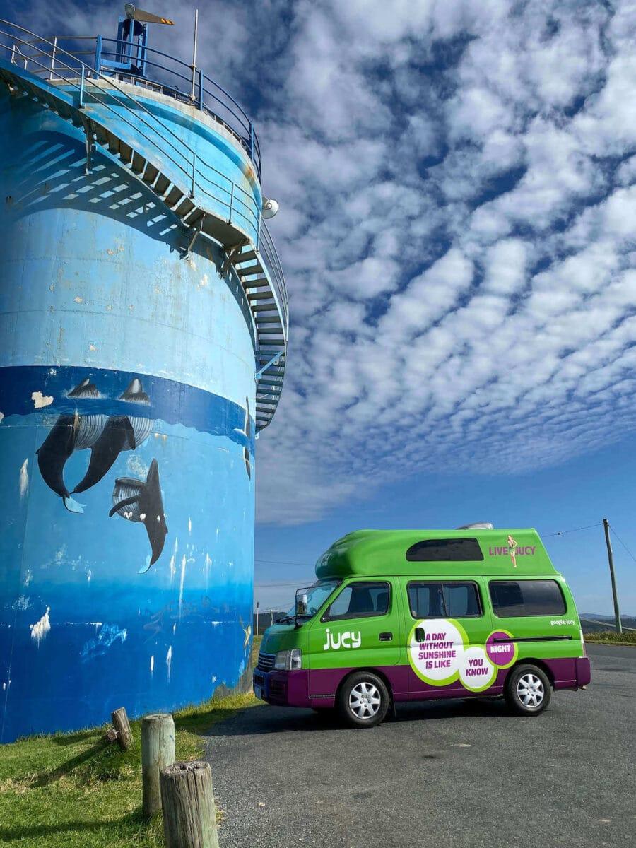 jucy campervan next to woolgoolga water tower