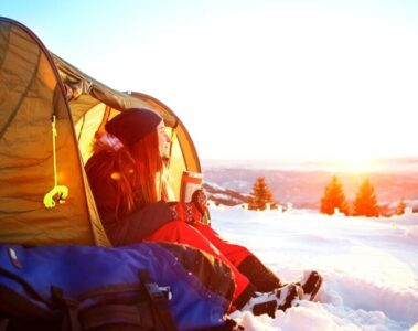sitting in tent in snow