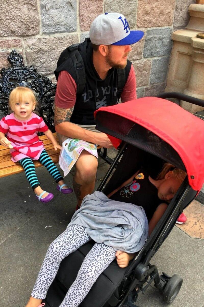 child sleeping in stroller at disneyland