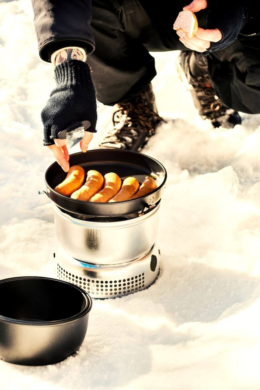 cooking over camp oven in snow