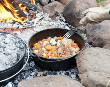cooking dinner in a dutch oven over a campfire