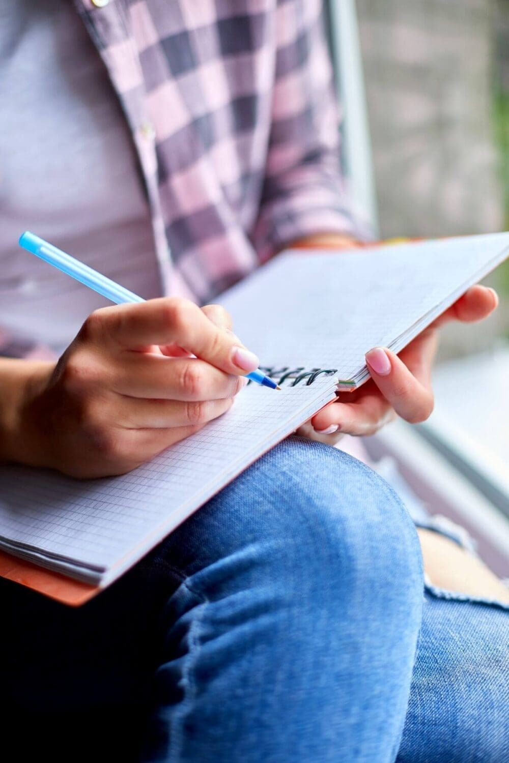 person writing in their journal