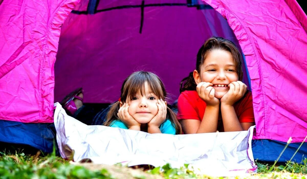 two little girls in their tent camping